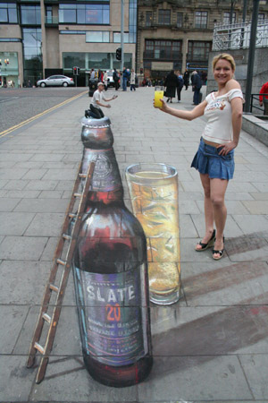 Julian Beever, 3d drawings a beer bottle.