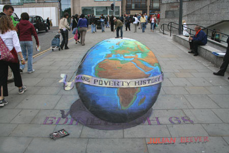 The planet with Julian Beever standing on top.